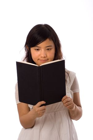 chinese girl play with book with black blank cover Stock Photo