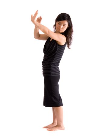 chinese girl standing shows hide gesture isolated Stock Photo - 4038868