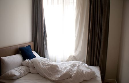 Comfortable bed in modern hotel in the morning Stock Photo - 4300649