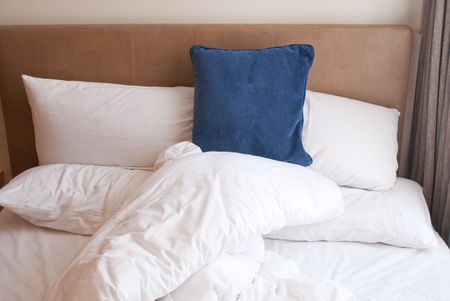 Comfortable bed in modern hotel in the morning Stock Photo - 4300651