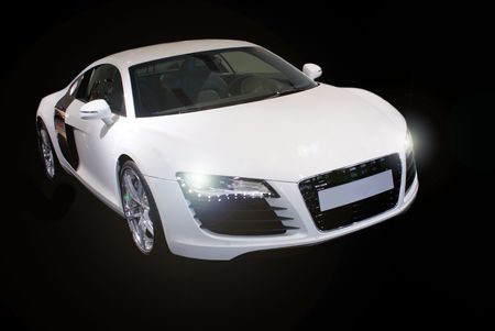 car tuning: fancy sports car isolated on black background
