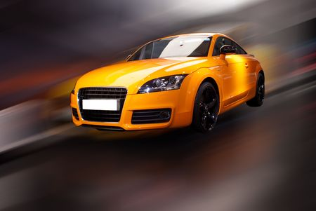 orange fancy sports car in motion with white lable photo