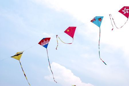 flying a kite: Waving asian countries national flag kites in action