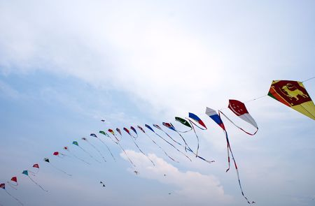 Waving asian countries national flag kites in action