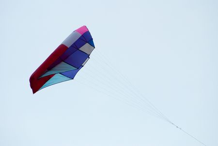 giant bed like kite in flying action photo