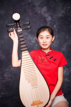 Chinese lute player in red shirt on performance
