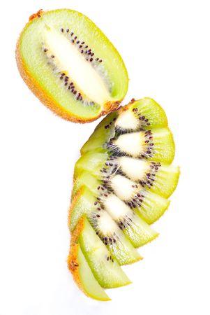 Sliced ripe fresh kiwi isolated on white photo