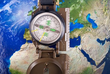 steel compass on travel map of blue globe Stock Photo - 4563451
