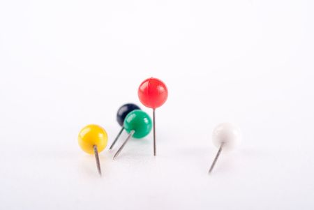 dispersed: dispersed colorful pins isolated with red standing out