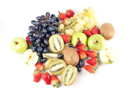 Assorted fresh fruits background including strawberry, apple, kiwi and black and green grape photo