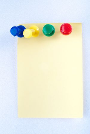 Yellow post it note with color pin isolated Stock Photo - 4580678