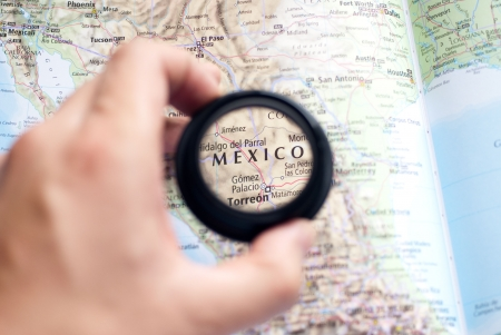magnifier: Selective focus on antique map of Mexico