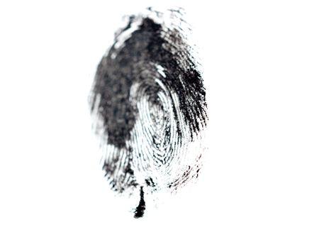 investigators: detail of black fingerprint isolated on white