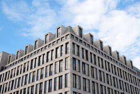 modern office building block exterior against blue sky Stock Photo