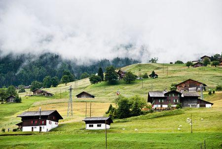Mountainous green scenery in Switzerland village in summer photo