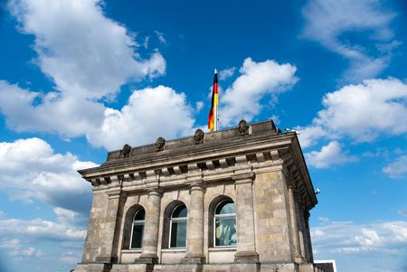 German national flag against blue sky in outdoor photo