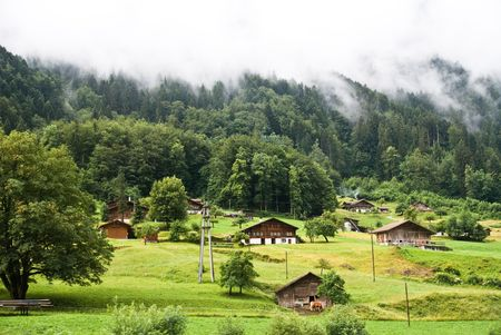 Mountainous green scenery in Switzerland village in summer photo