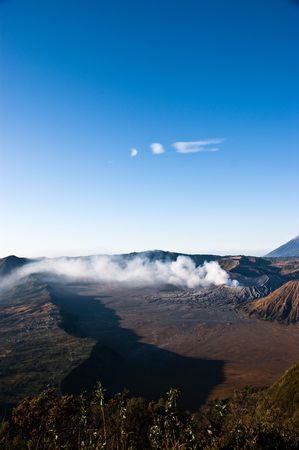 active volcano: Active volcano Mountain Bromo amazing sunrise with gas eruption Stock Photo