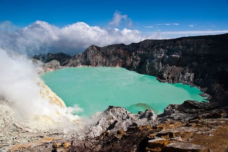 Milky blue lake in geographic asian active volcano Stock Photo