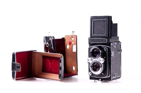 Antique medium format film mechanical camera isolated on white photo