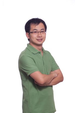 Chinese young male in green polo shirt with arms crossed photo