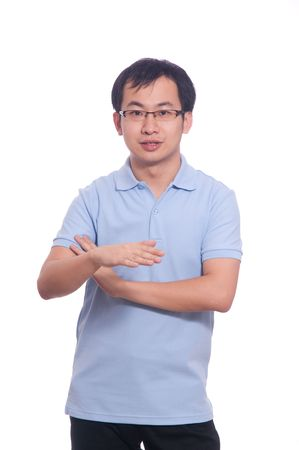 Confident chinese young male in blue polo shirt