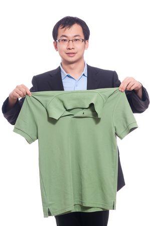 Asian young male business man neaten his polo shirt Stock Photo - 5909018