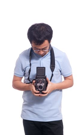 Aisan Chinese young photographer with antique film camera