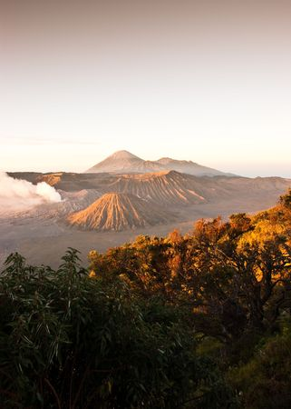excite: Active volcano Mountain Bromo amazing sunrise with gas eruption Stock Photo