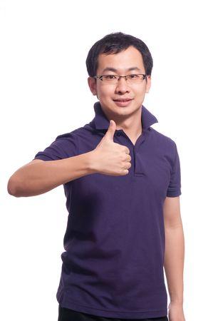親指のアップで中国の若い男性の笑顔 写真素材