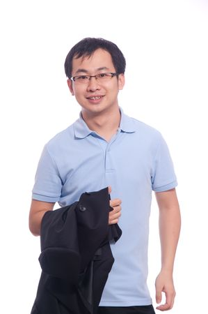 young chinese student in blue polo shirt holding black jacket in photo