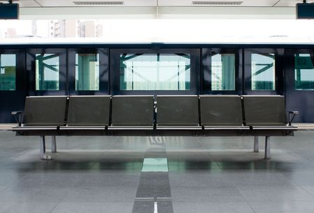 empty steel seats in urban train station Editorial