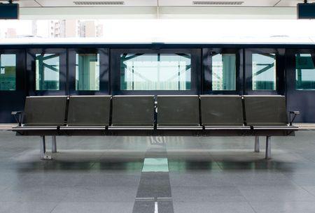 empty steel seats in urban train station Éditoriale