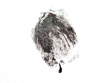 白で隔離される黒い指紋の詳細 写真素材