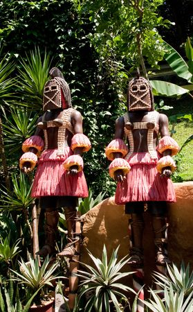 originality: wood sculpture of african originality with red cloth