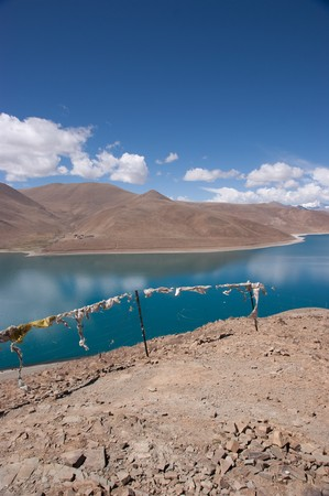 Blue lake with surrounding mountains in great tibet area Stock Photo - 7454759