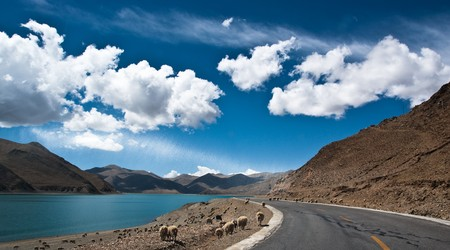 rocky road: Blue lake with surrounding mountains in great tibet area