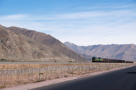 train driving through mountainous landscape into wildness Stock Photo - 7691318