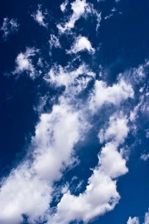 white cloudscape against clear blue sky