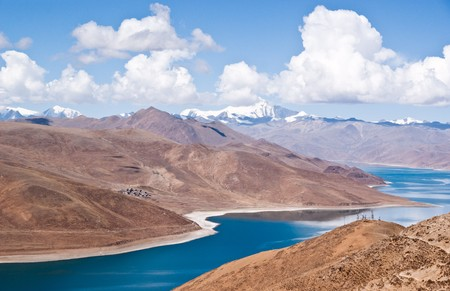 Blue lake with surrounding mountains in great tibet area