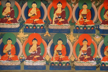 buddha painting on the interior wall of religious temple photo