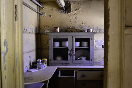 Interior shot from an abandoned building. Kitchen area.