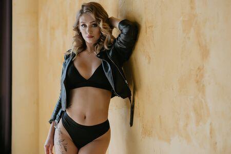 blonde girl in lingerie breasts