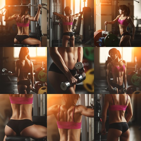 bra model: Brutal athletic woman pumping up muscles with dumbbells. Brunette sexy fitness girl in pink sport wear with perfect body in the gym posing before training set. Attractive fitness woman Stock Photo