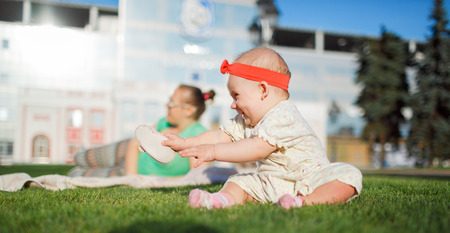 Happy baby on the grass photo