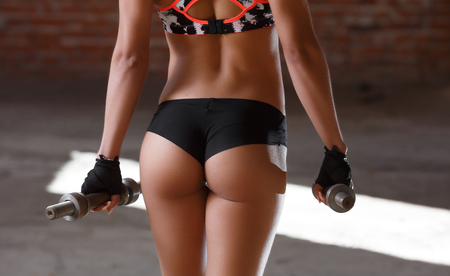 Beautiful athletic ass close-up. Perfect woman sexy buttocks in lingerie. Clean healthy skin. Part of body. Healthy lifestyle, diet and fitness