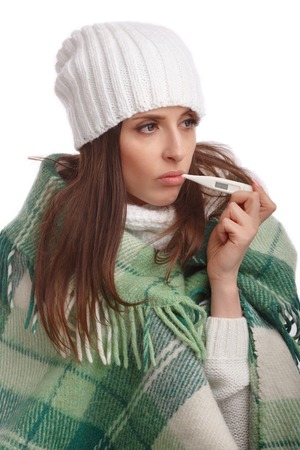 colds: Sick girl with a thermometer on a white background, isolate, flu, colds