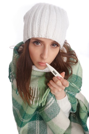 ailment: Sick girl with a thermometer on a white background, isolate, flu, colds. Top view Stock Photo