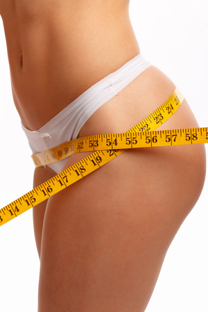 perfect waist: Perfect women body measuring waist. Isolation on white