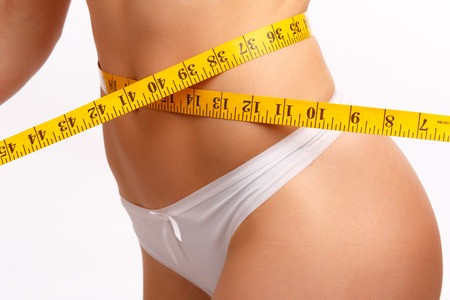 measuring waist: Perfect women body measuring waist. Isolation on white